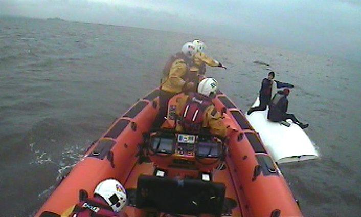 The crew reaches the stricken sailors.