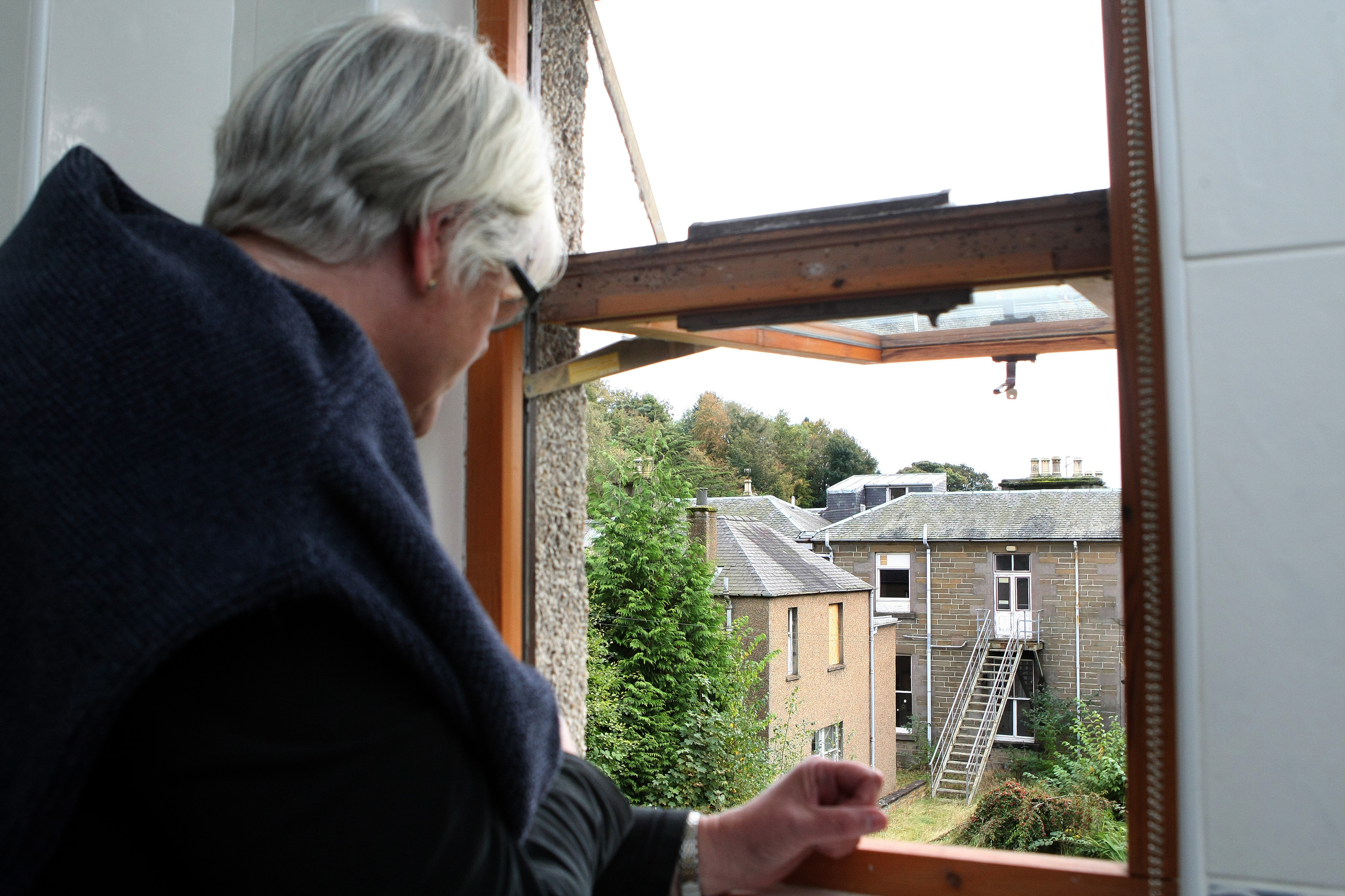 Susan Ashton looking out at the spot where the proposed annexe will be.