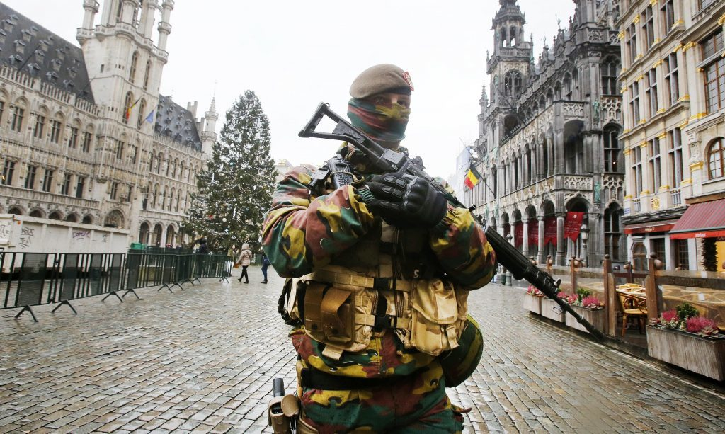 A Belgium police officer patrols the Grand Place in central Brussels, Belgium, on November 24, 2015.