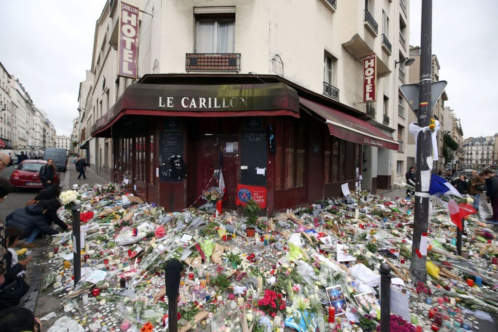 Floral tributes and candles left at Le Carillon, Paris, after terror attacks killed at least 129 people in the city in November 2015.
