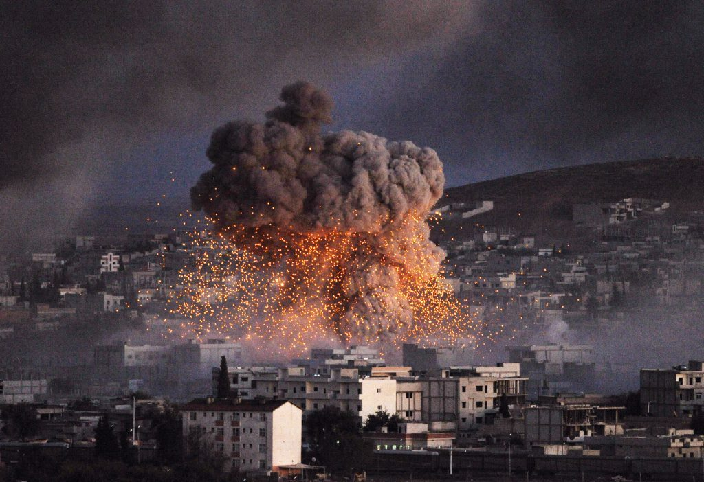 An explosion rocks the Syrian city of Kobane during a reported suicide car bomb attack by the militants of Islamic State (ISIS) in October 2014