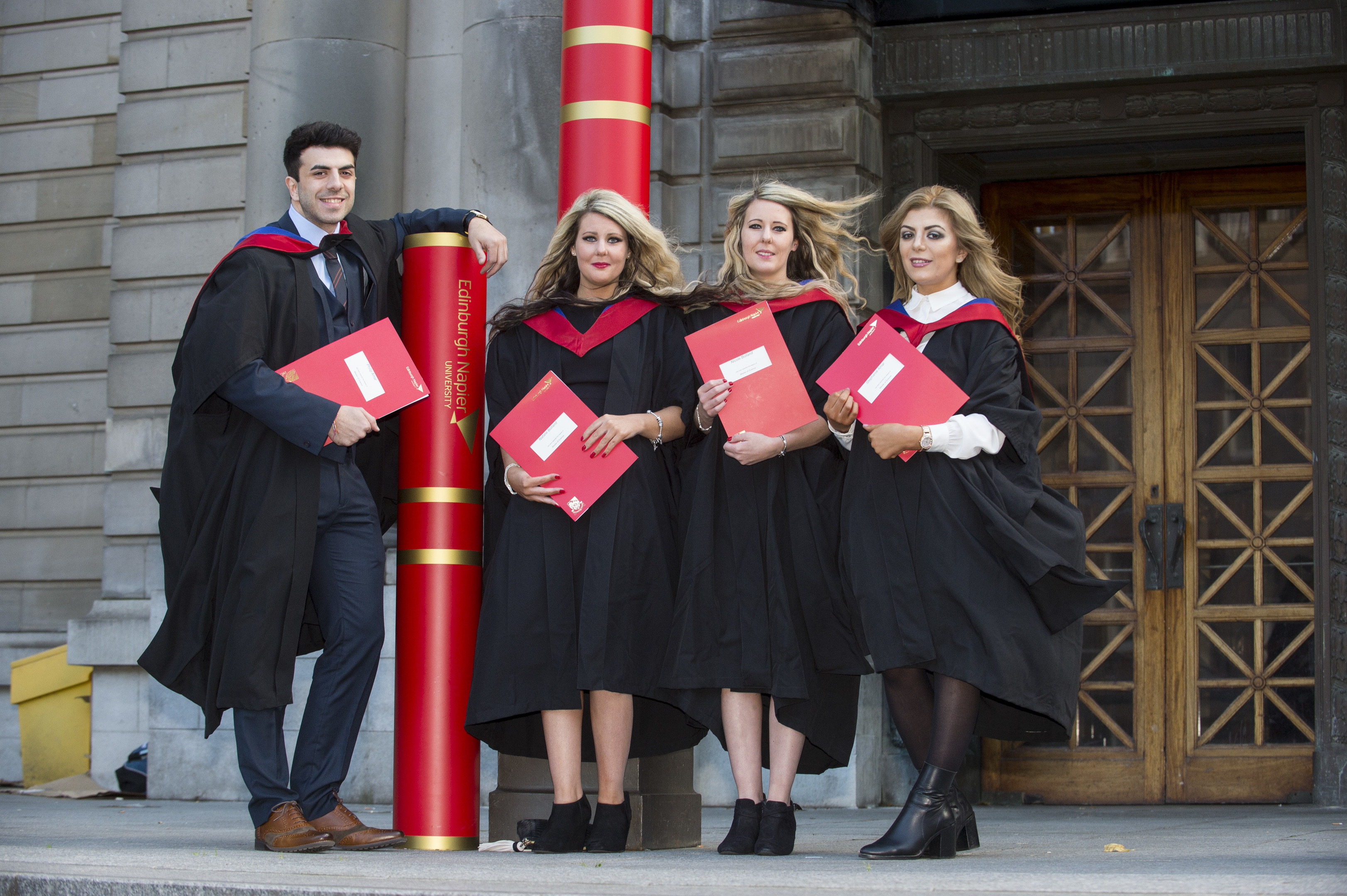 Twins and siblings graduating from the Human resources Management Masters programme.  Brother and sister Phillip and Stephanie Amar and identical twins Natalie and Nicole Bolland.  L-R Philip, Natalie, Nicole and Stephanie.