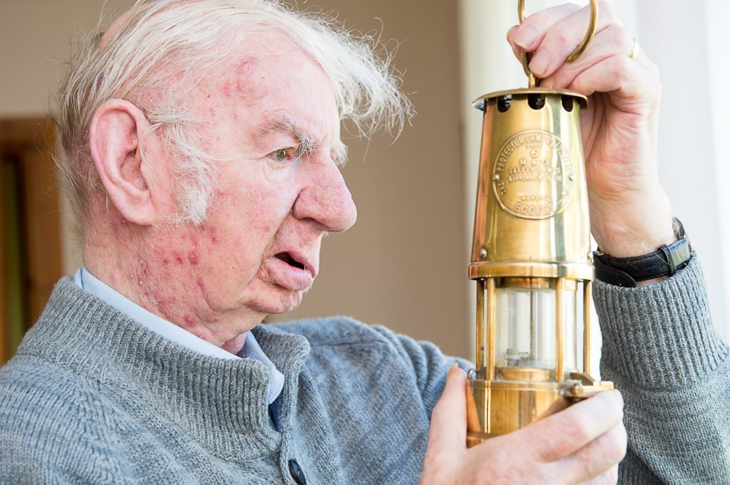 Willie Clarke with an old miners' lamp