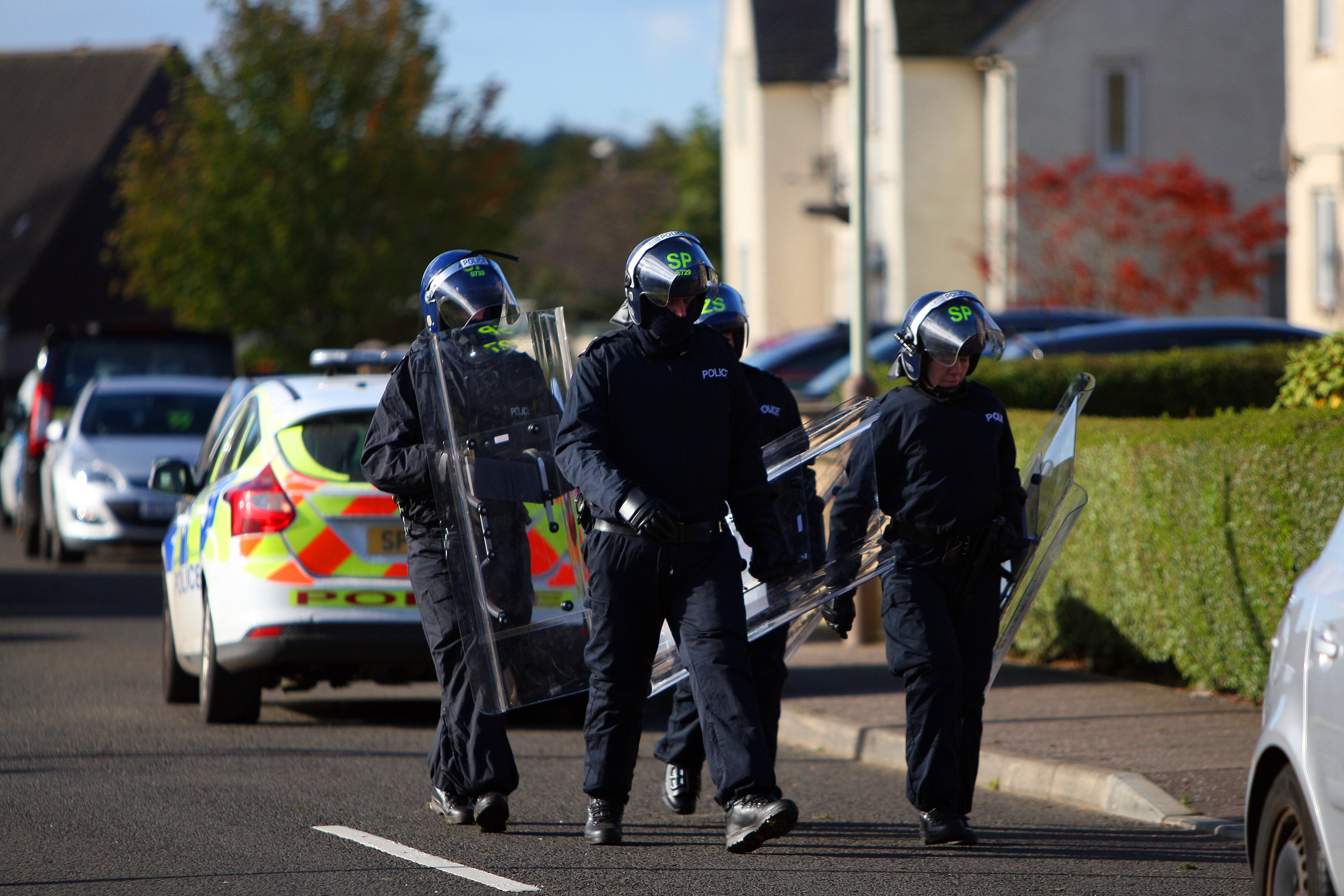 Riot police descend on a property in Wellbank on Sunday morning.