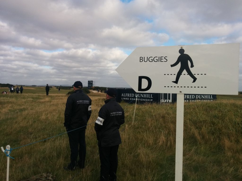 Dunhillb marshals manning the controlled crossing across the 4th and 15th fairways on the Old Course, St Andrews