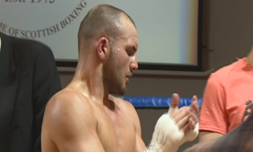 A concerned Dale Evans applauding Mike Towell after the fight was stopped.