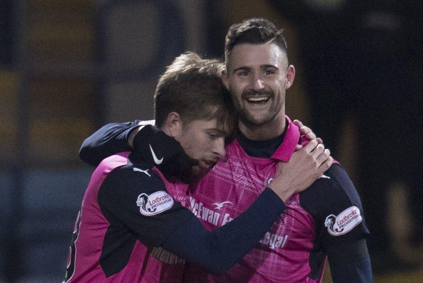 Craig Wighton celebrates with Marcus Haber.