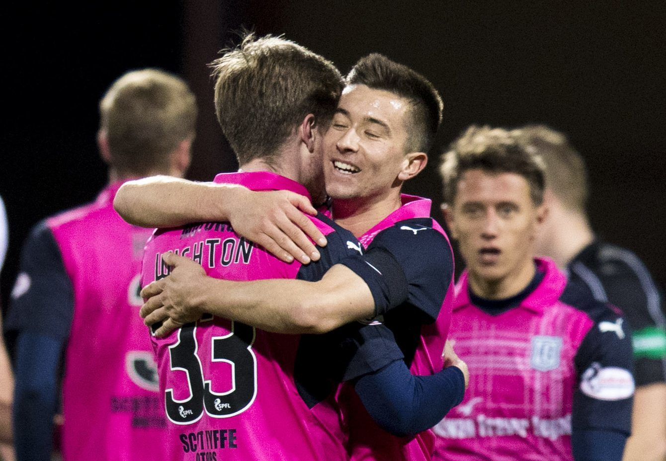Cammy Kerr celebrates with Craig Wighton at full time.