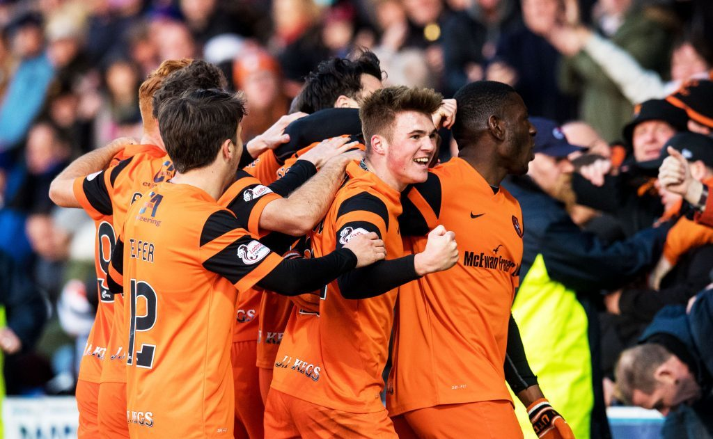 United celebrate one of their goals at Palmerston.