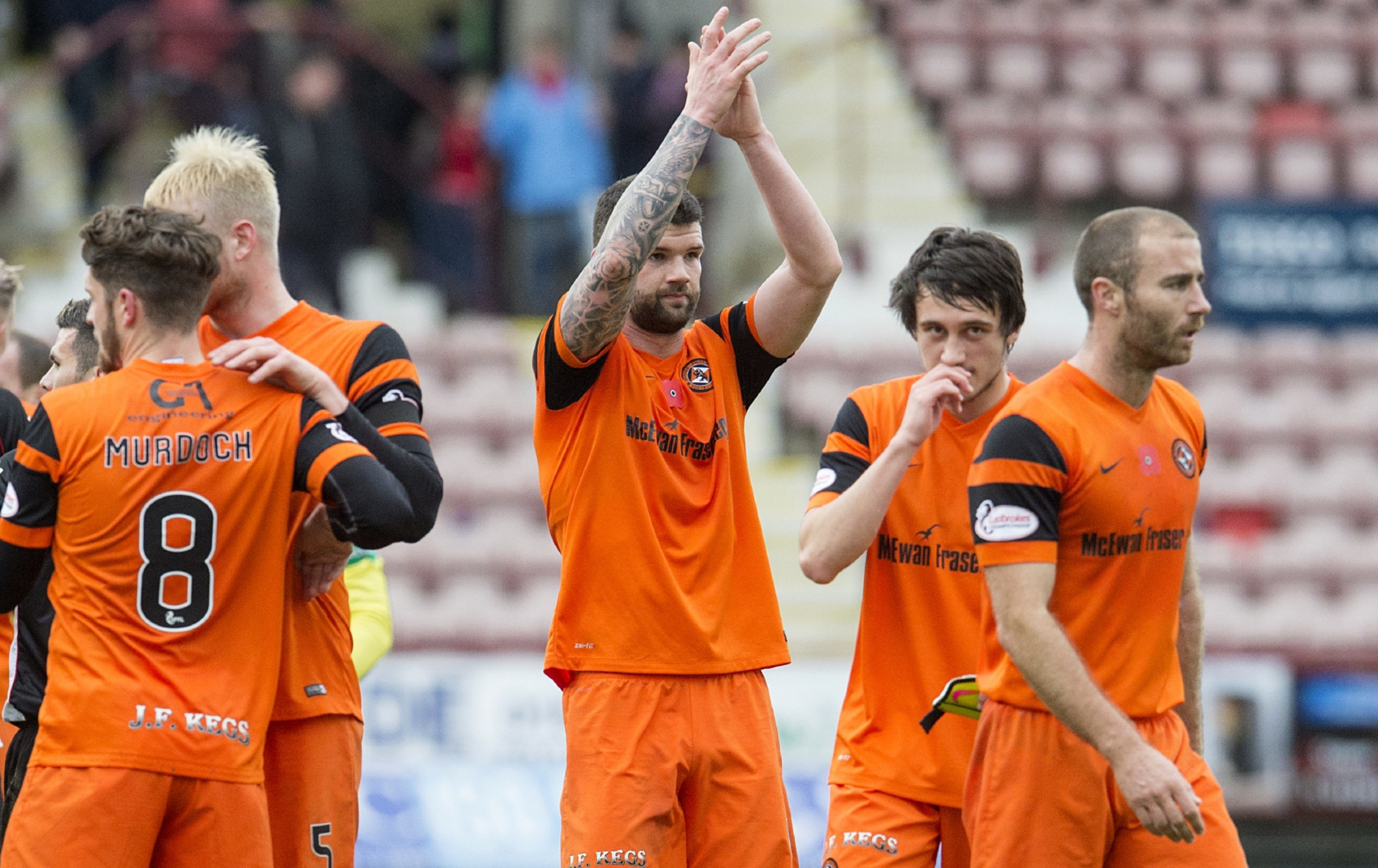 Mark Durnan applauds the United fans at full-time.