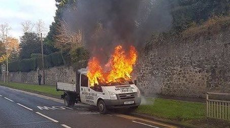 The van was engulfed in flames.