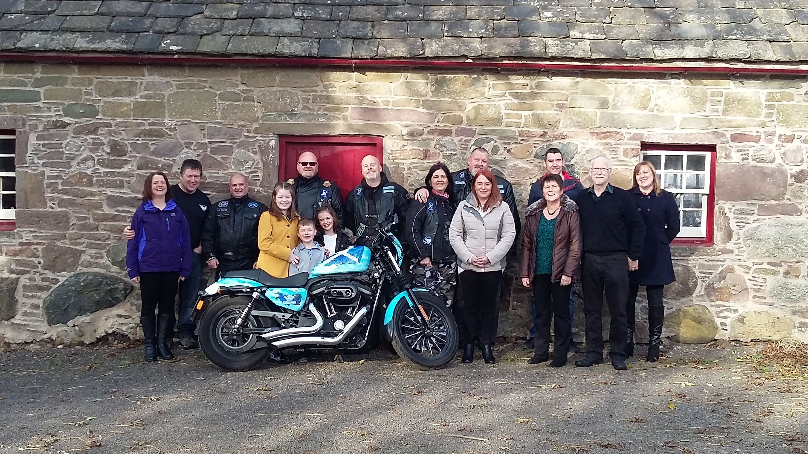 The memorial gathering at Davidson Cottage with the special bike