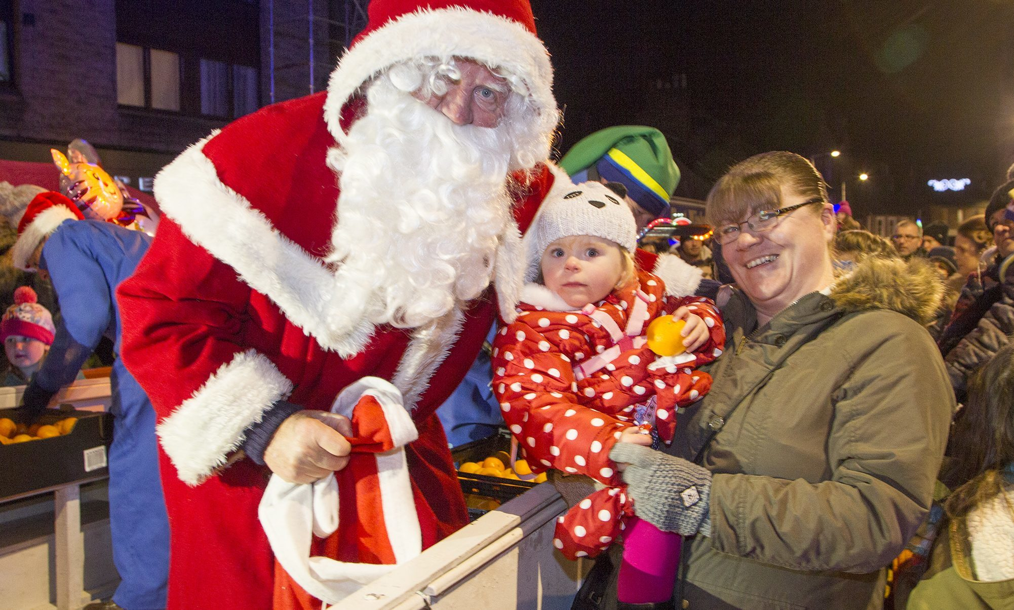 Santa meeting a young visitor at the 2016 Forfar Christmas lights switch-on.