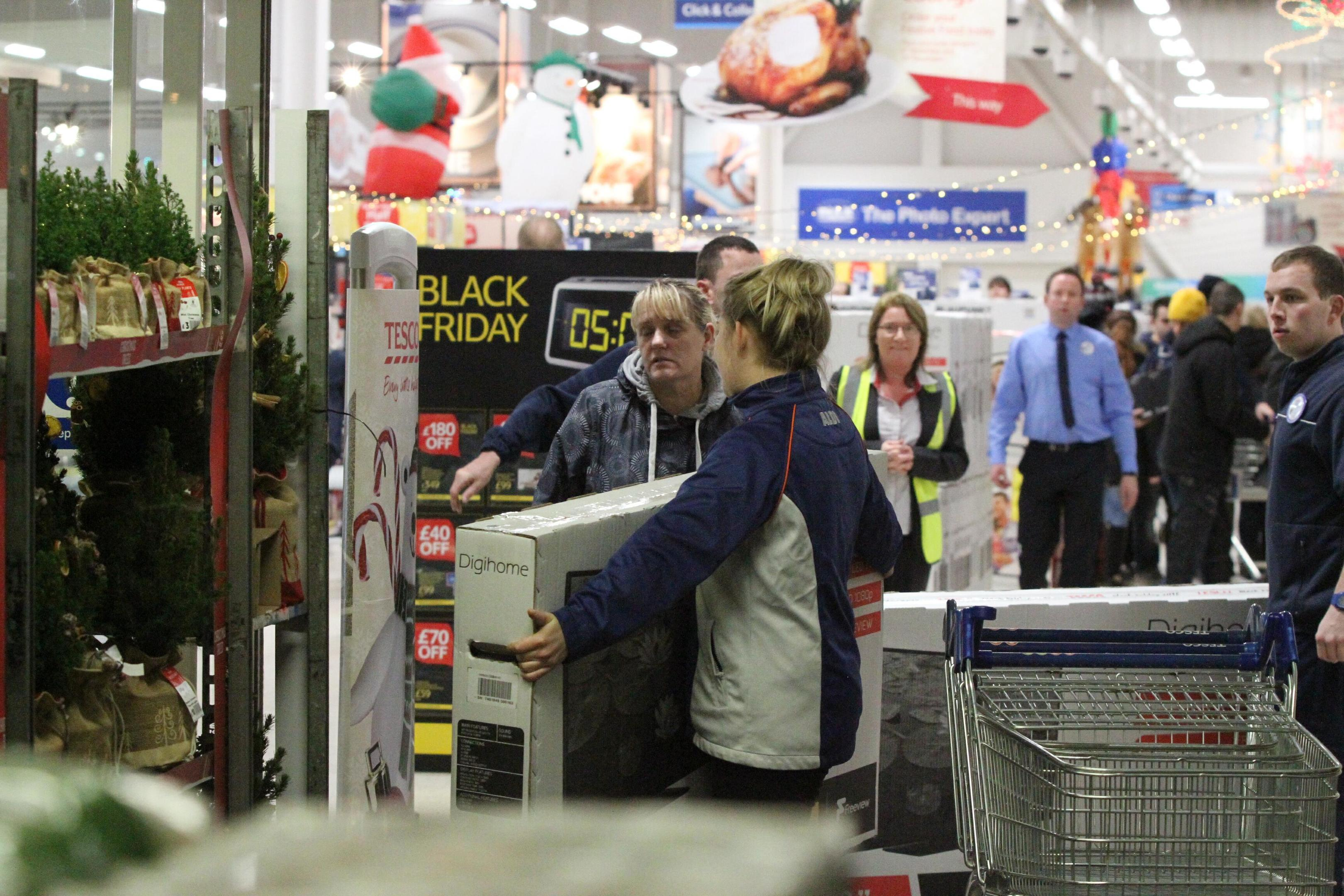 Shoppers hunt for bargains on Black Friday last year.