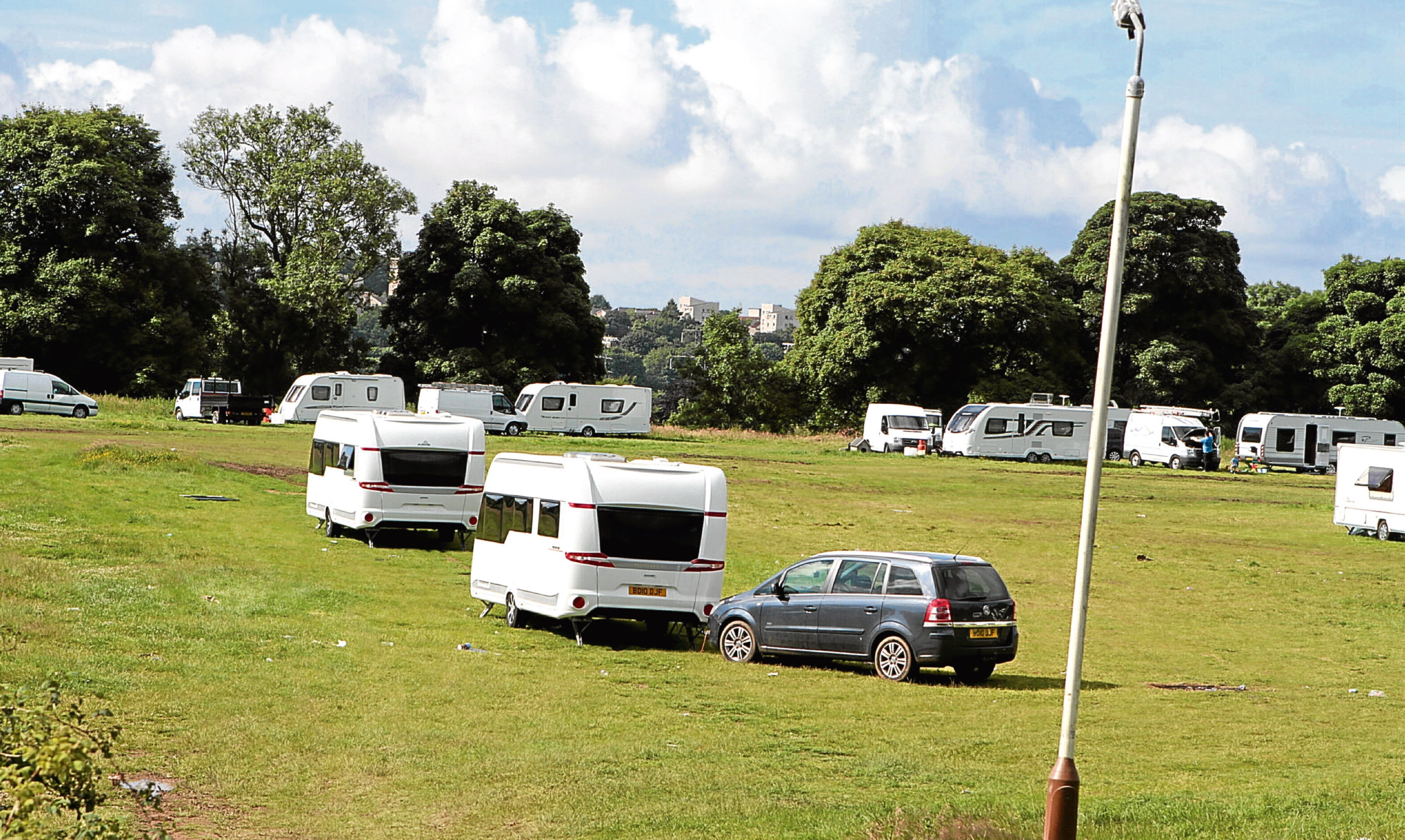 Travellers' vehicles during a stop near Camperdown Park, Dundee.