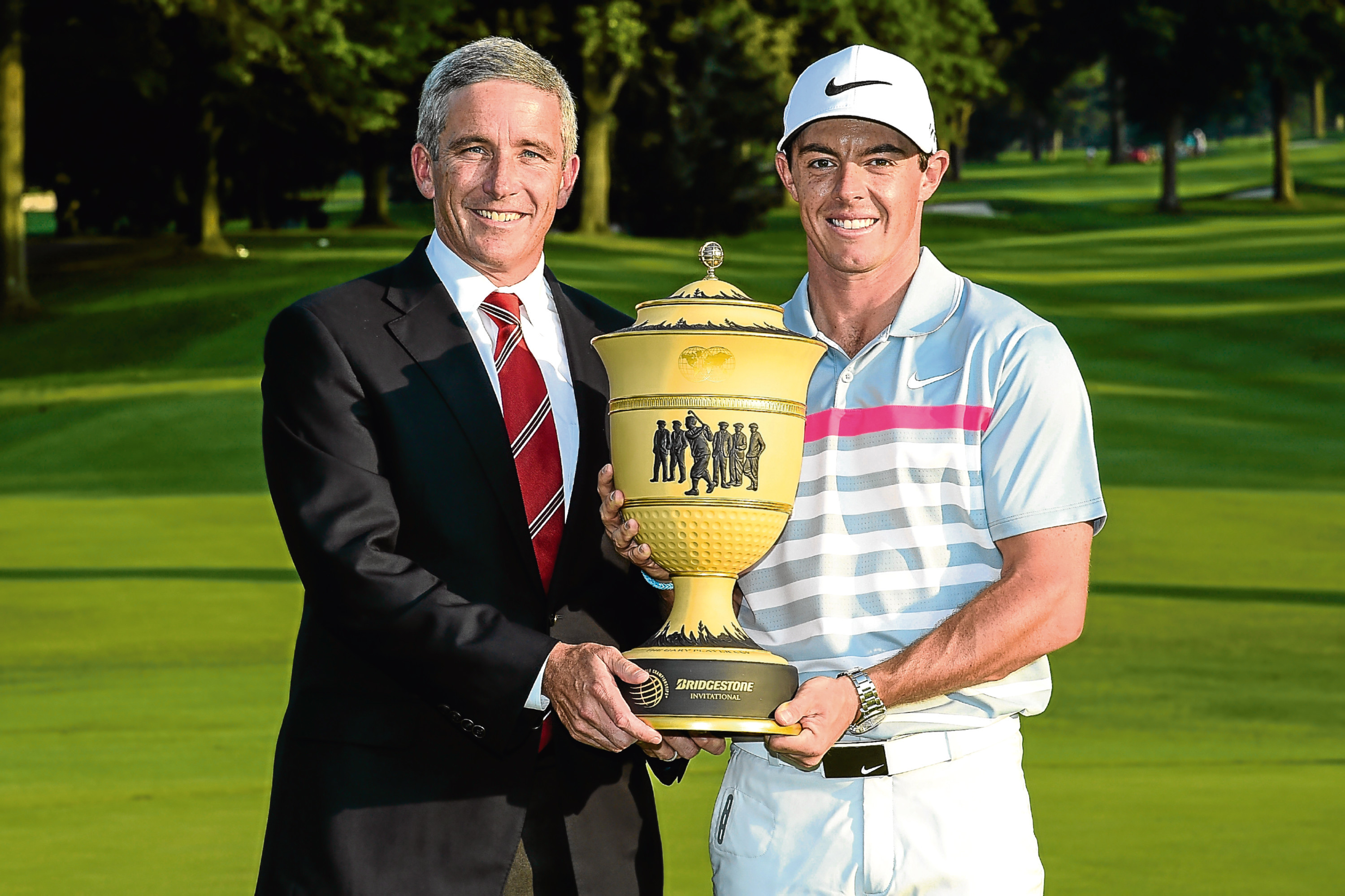 Jay Monahan and Rory McIlroy.