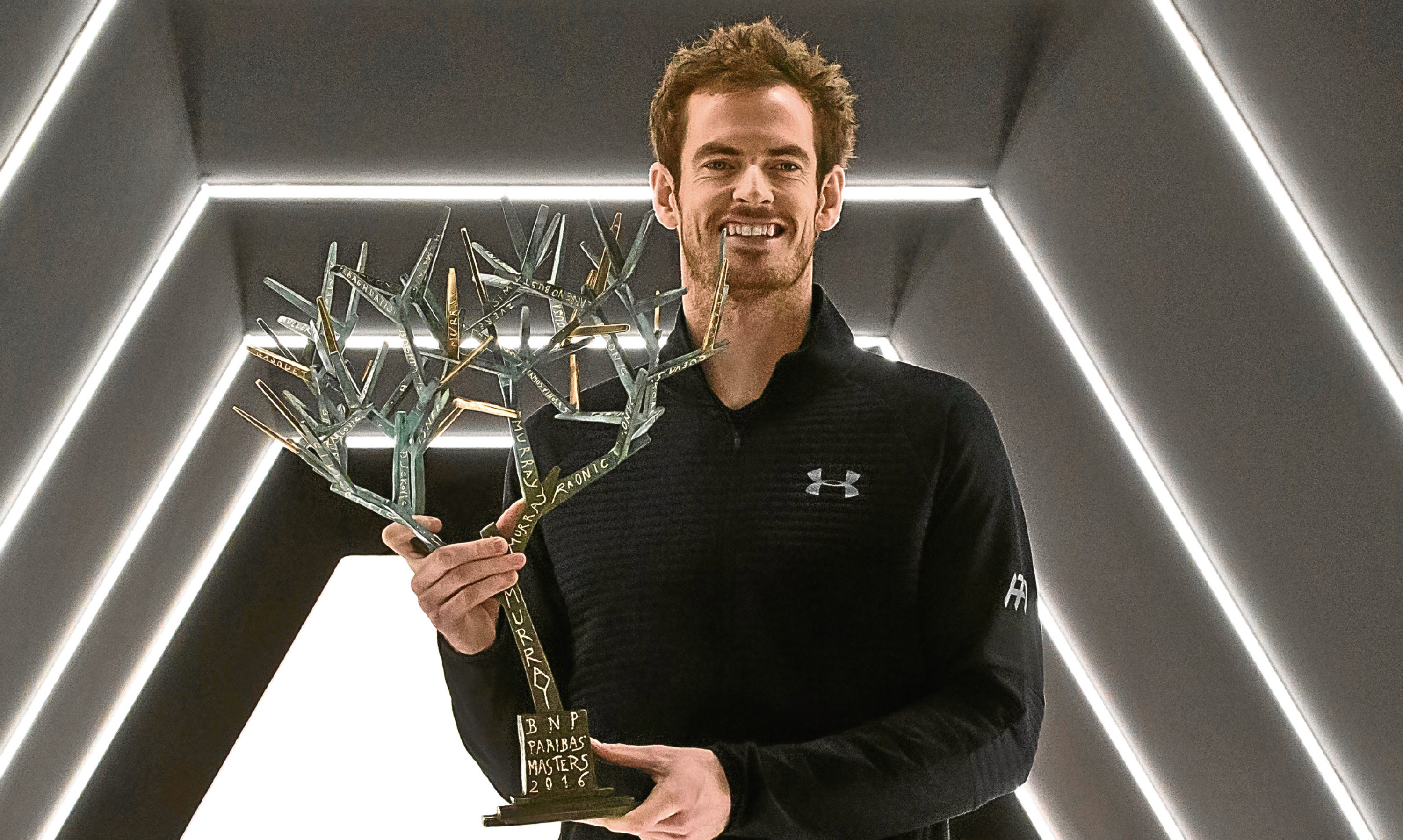 Andy Murray with his Paris Masters trophy. His modest reaction to becoming world number one mens singles tennis player pleased Helen.
