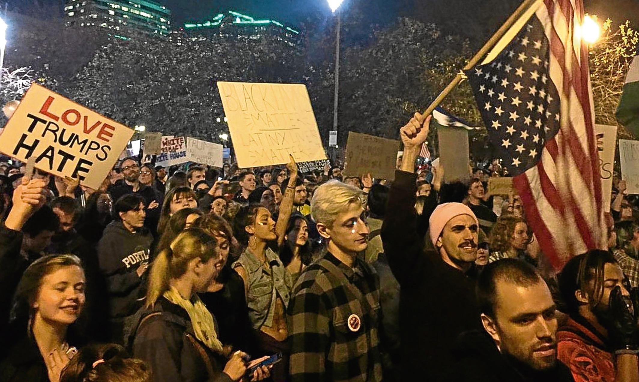 Anti-Trump protesters take to the streets of Portland, Oregon.