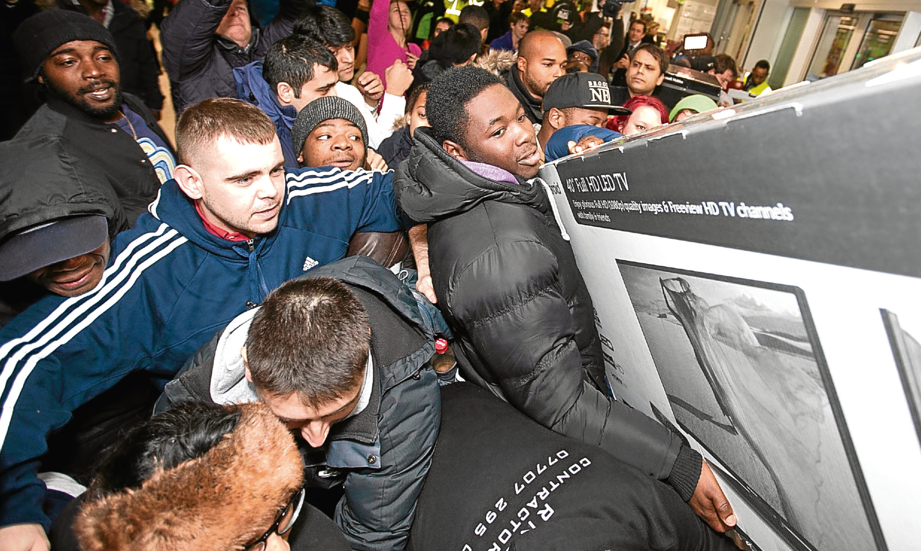 Scuffles broke out in UK stores as customers fought for Black Friday bargains in 2014