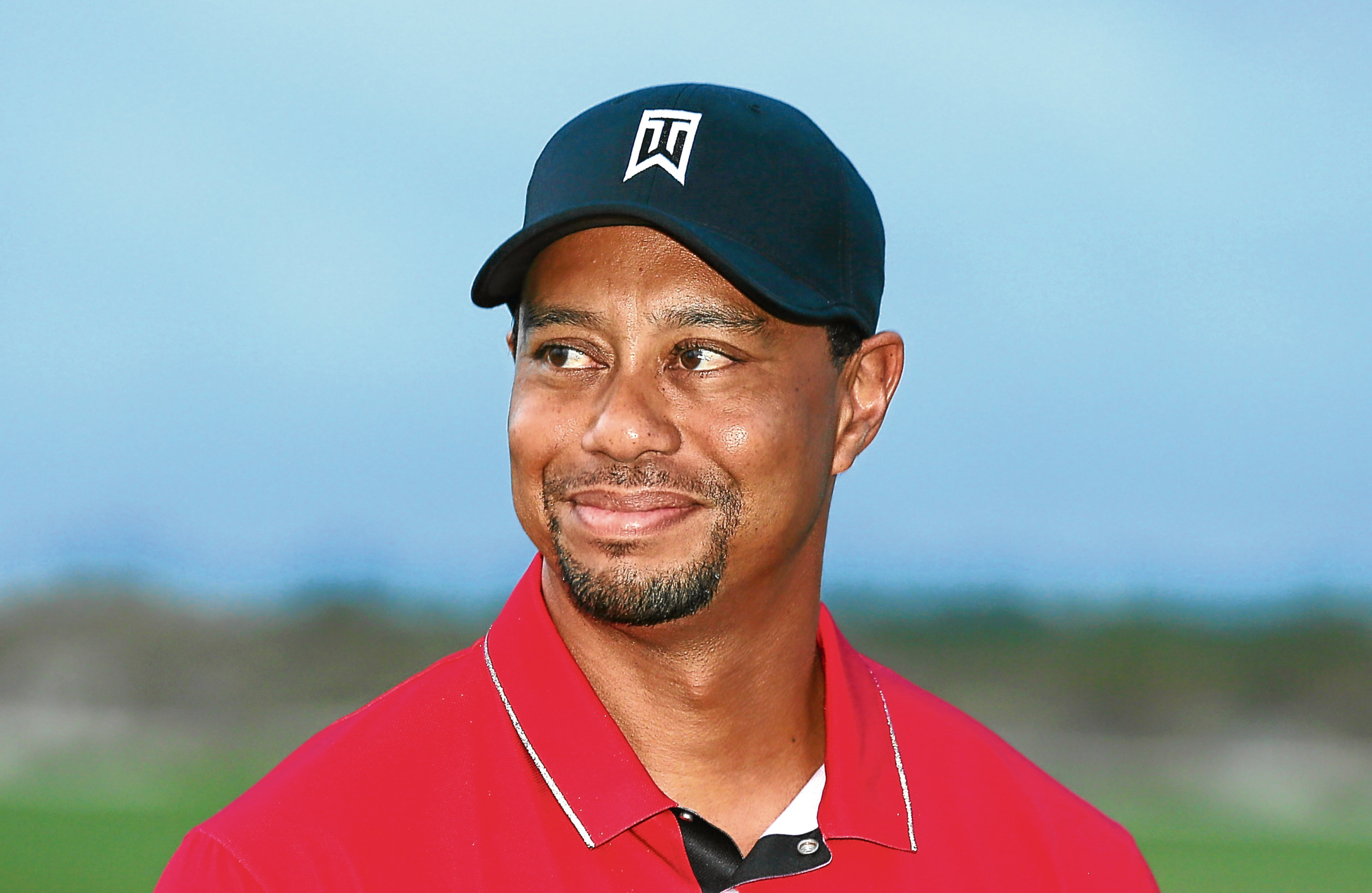 Tiger Woods is smiling again.