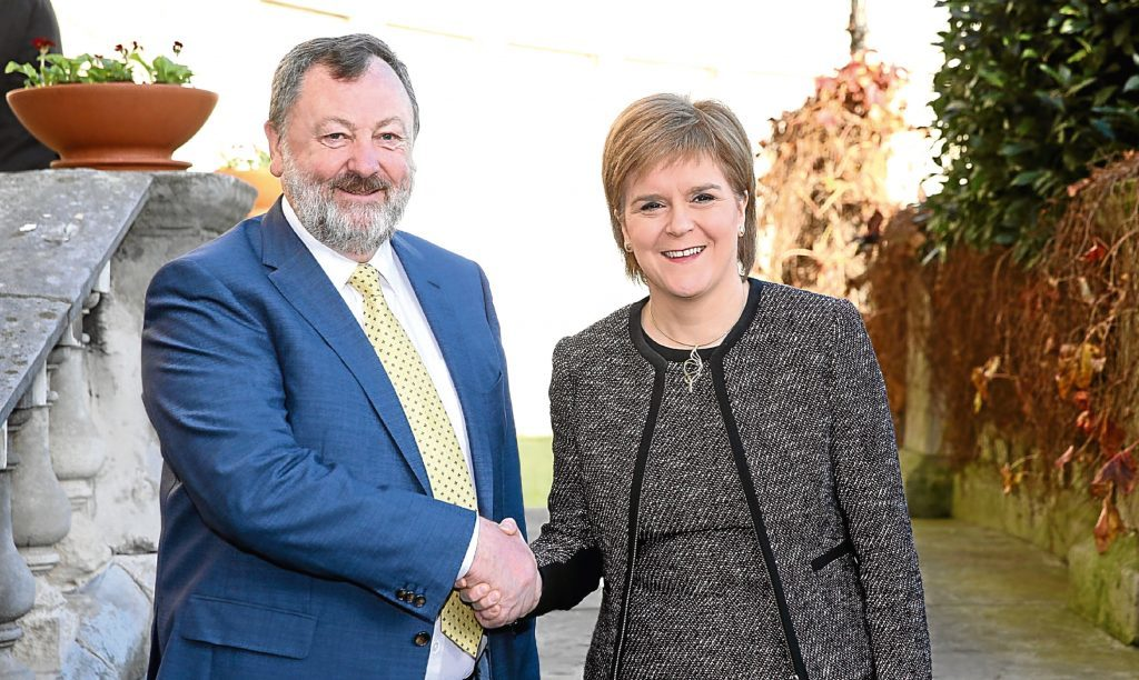 Irish politician Denis ODonovan greets First Minister Nicola Sturgeon at Leinster House, Dublin, where she was due to address the Seanad as part of her two-day visit to Ireland.