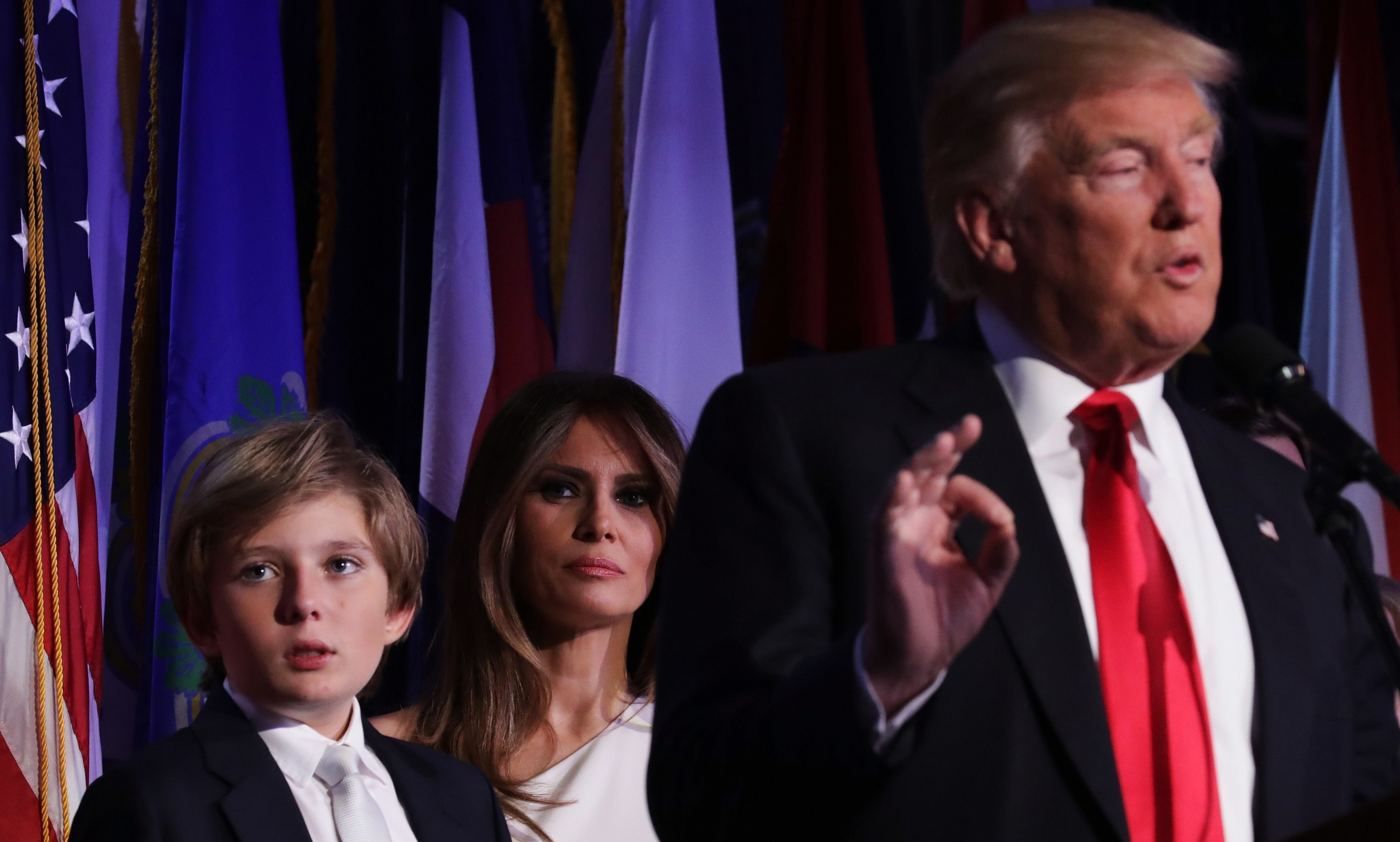 Republican president-elect Donald Trump delivers his acceptance speech as his son Barron Trump and wife Melania Trump looks on during his election night event at the New York Hilton Midtown