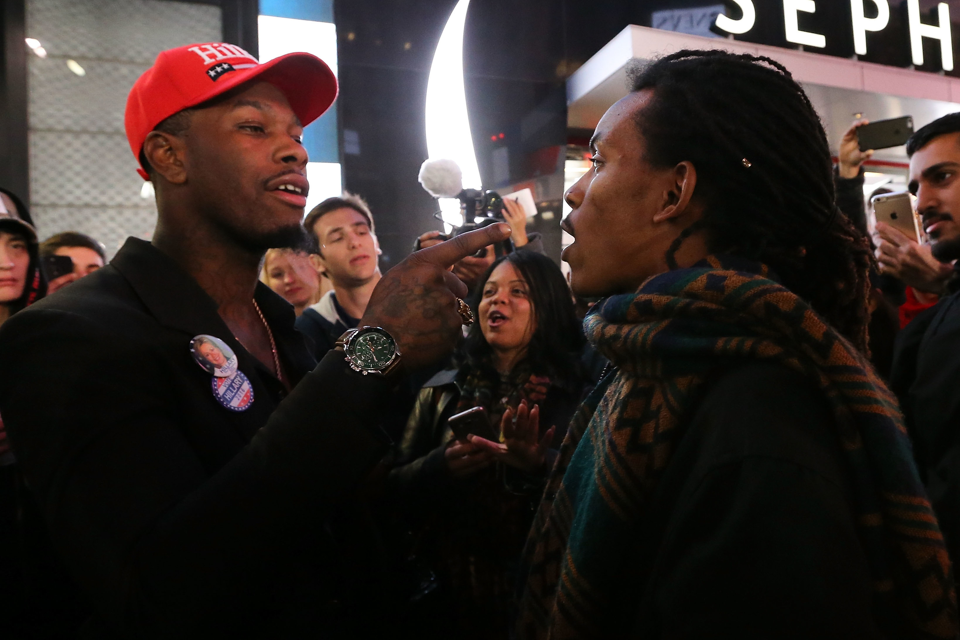 Donald Trump supporters and Hillary Clinton supporters clash outside in Times Square