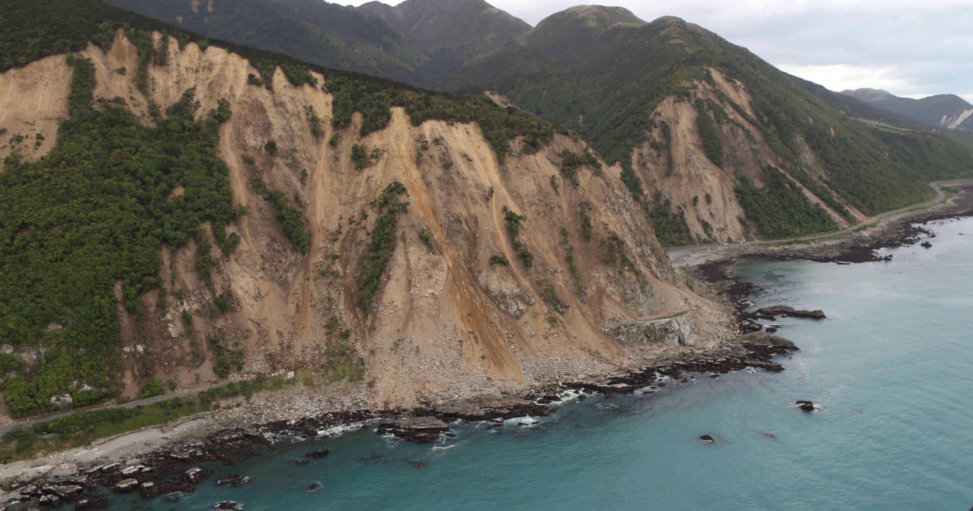 Huge slips, caused by the 7.5 earthquake, are seen blocking State Highway One.