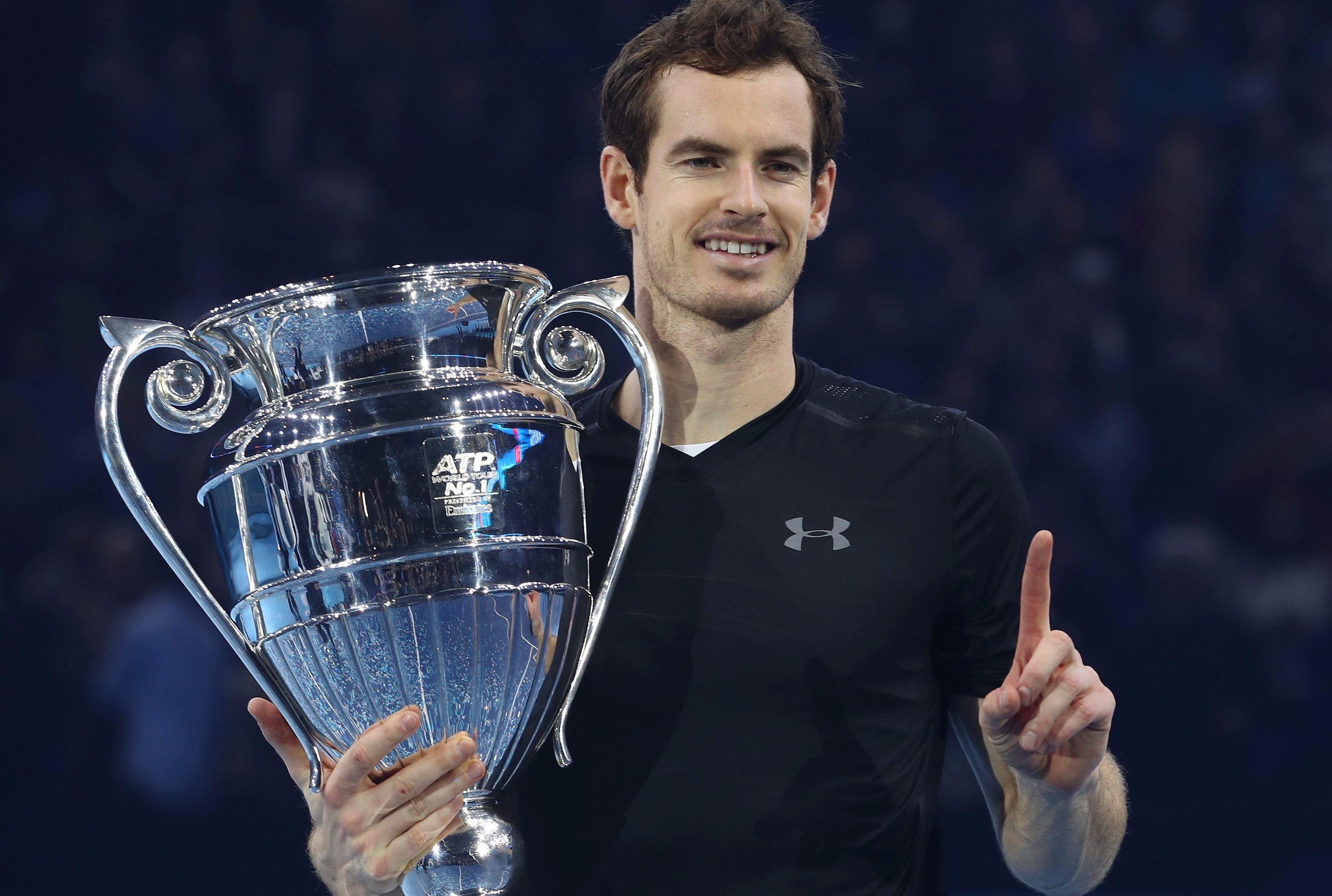 Andy Murray shows off his winner's trophy.