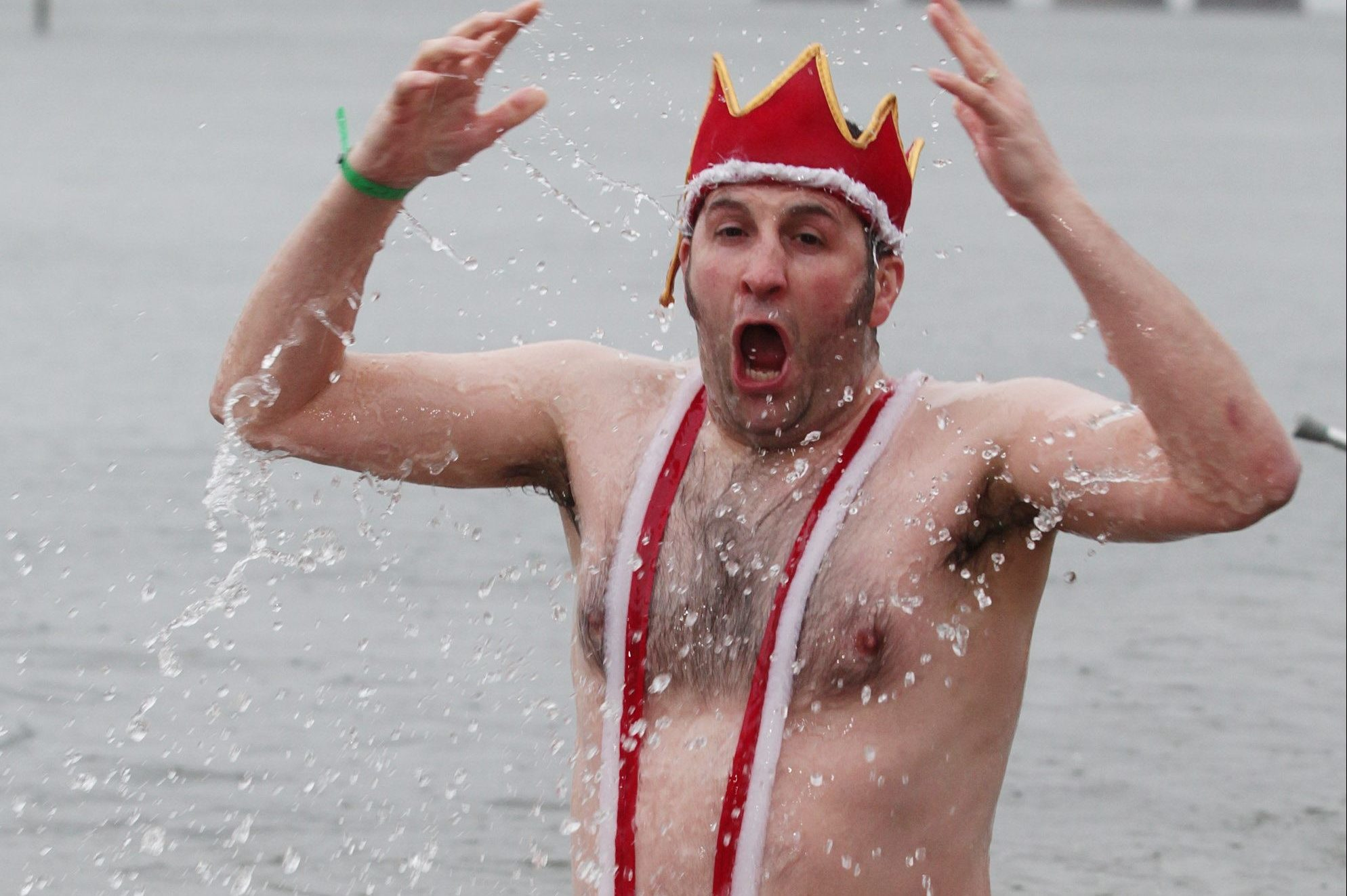 A man wears a Mankini during a festive dook.