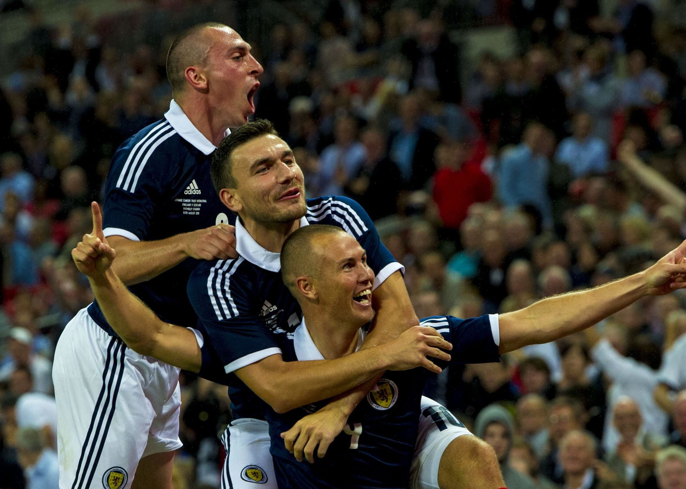 Robert Snodgrass celebrates Kenny Miller's goal at Wembley.