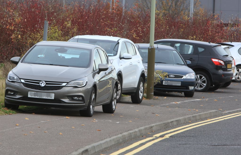 Cars parked on the pavement in Auld Bond Road, which were ticketed on Wednesday.