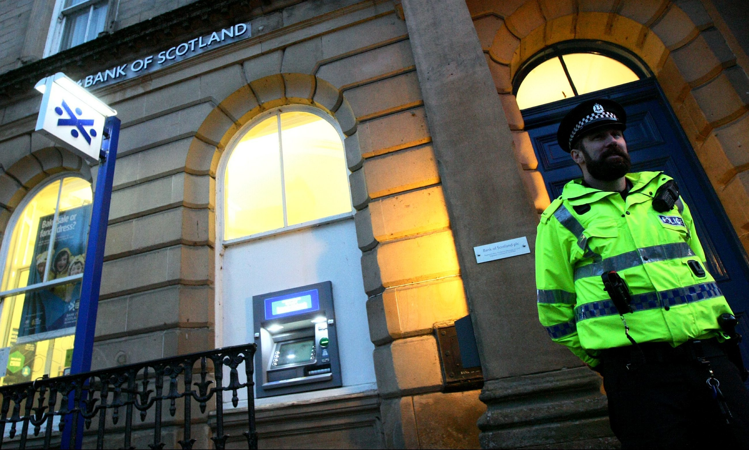 A police officer outside the bank branch on Tuesday.