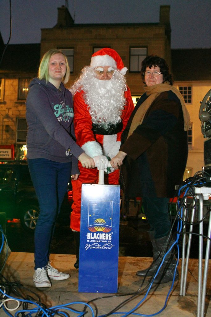 Santa takes the plunge with Alana and Sue in Cupar.