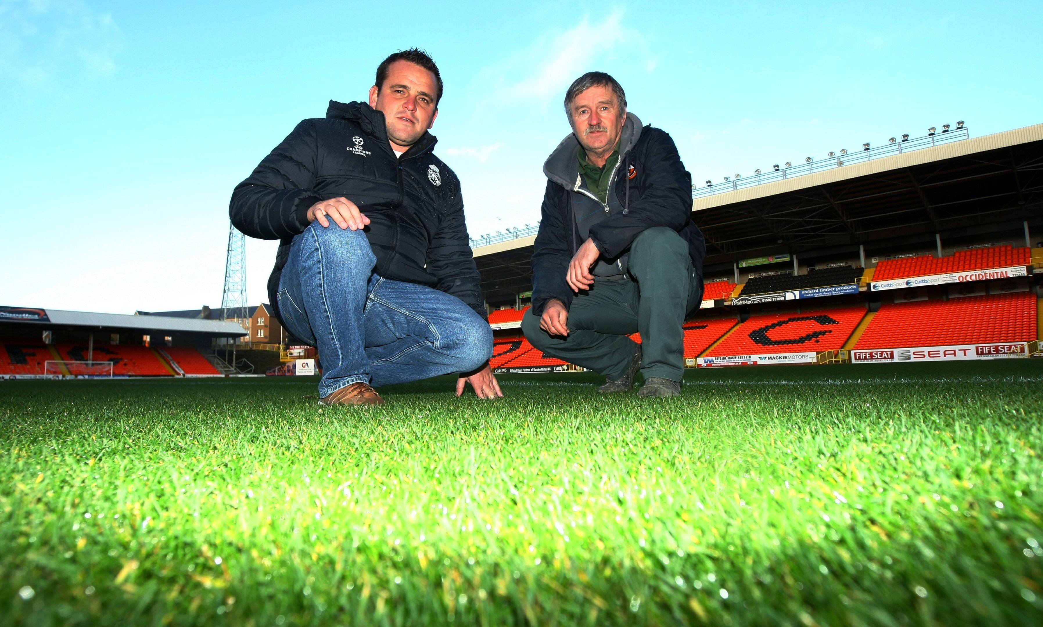 Real Madrid groundsman Paul Burgess chatting with Tannadice head groundsman Billy Milton.