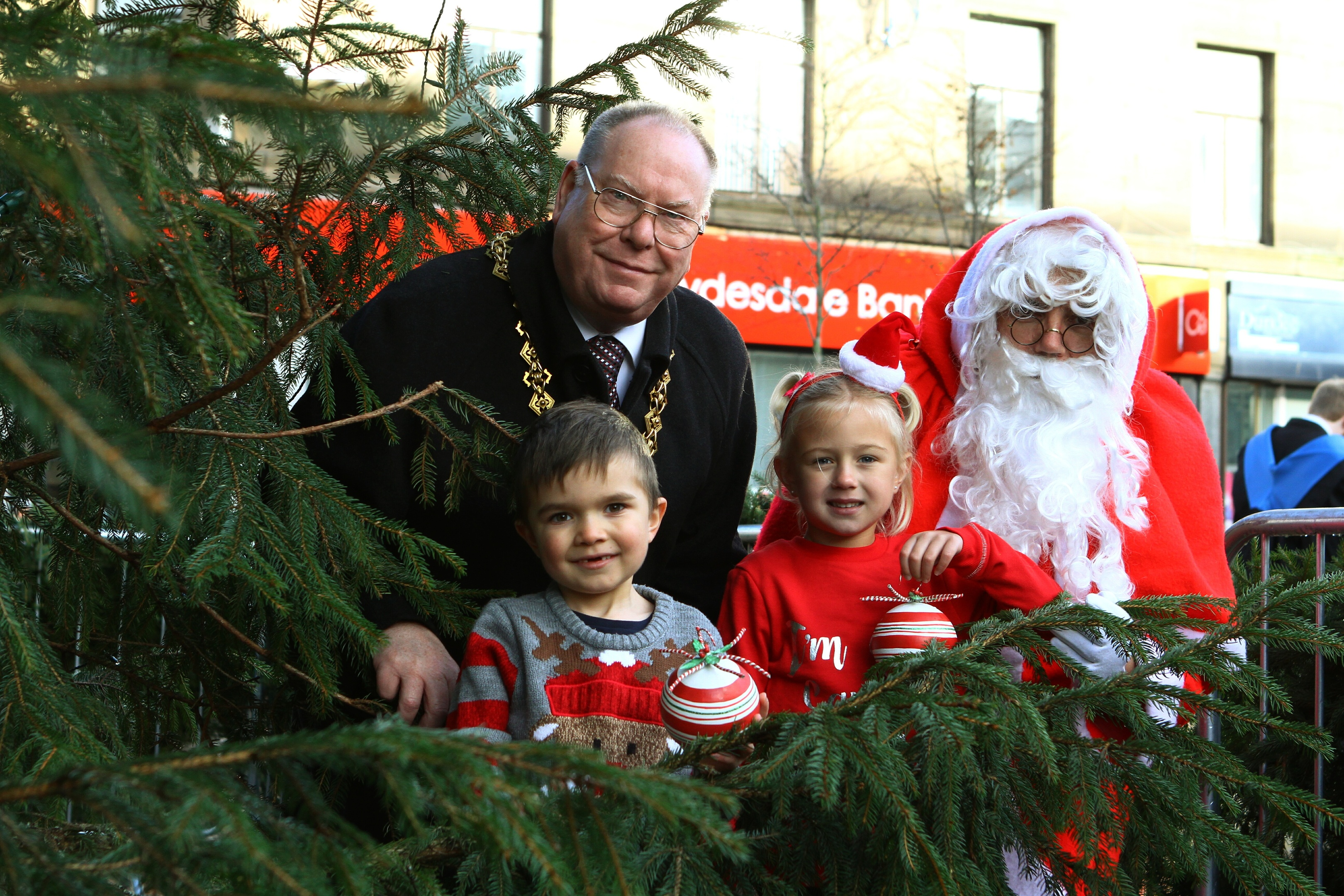 Lord Provost Bob Duncan with Santa, and JJ Brown, left, and Zoe Milton from Showcase The Street.