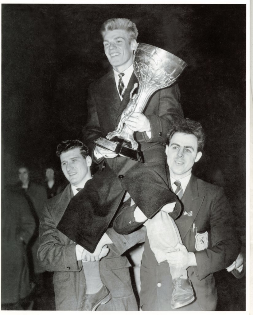 Dick McTaggart arrives back in Dundee with the gold medal and the Val Barker Cup.