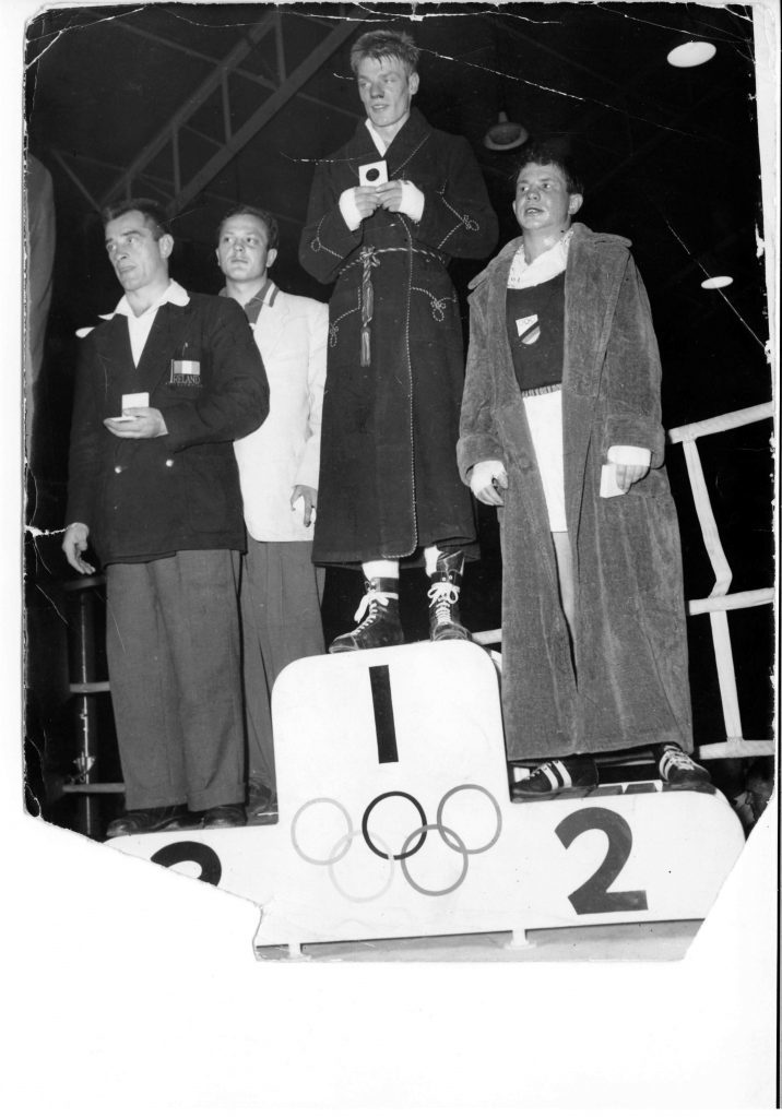 Dick McTaggart on the podium after winning gold at the 1956 Melbourne Olympics