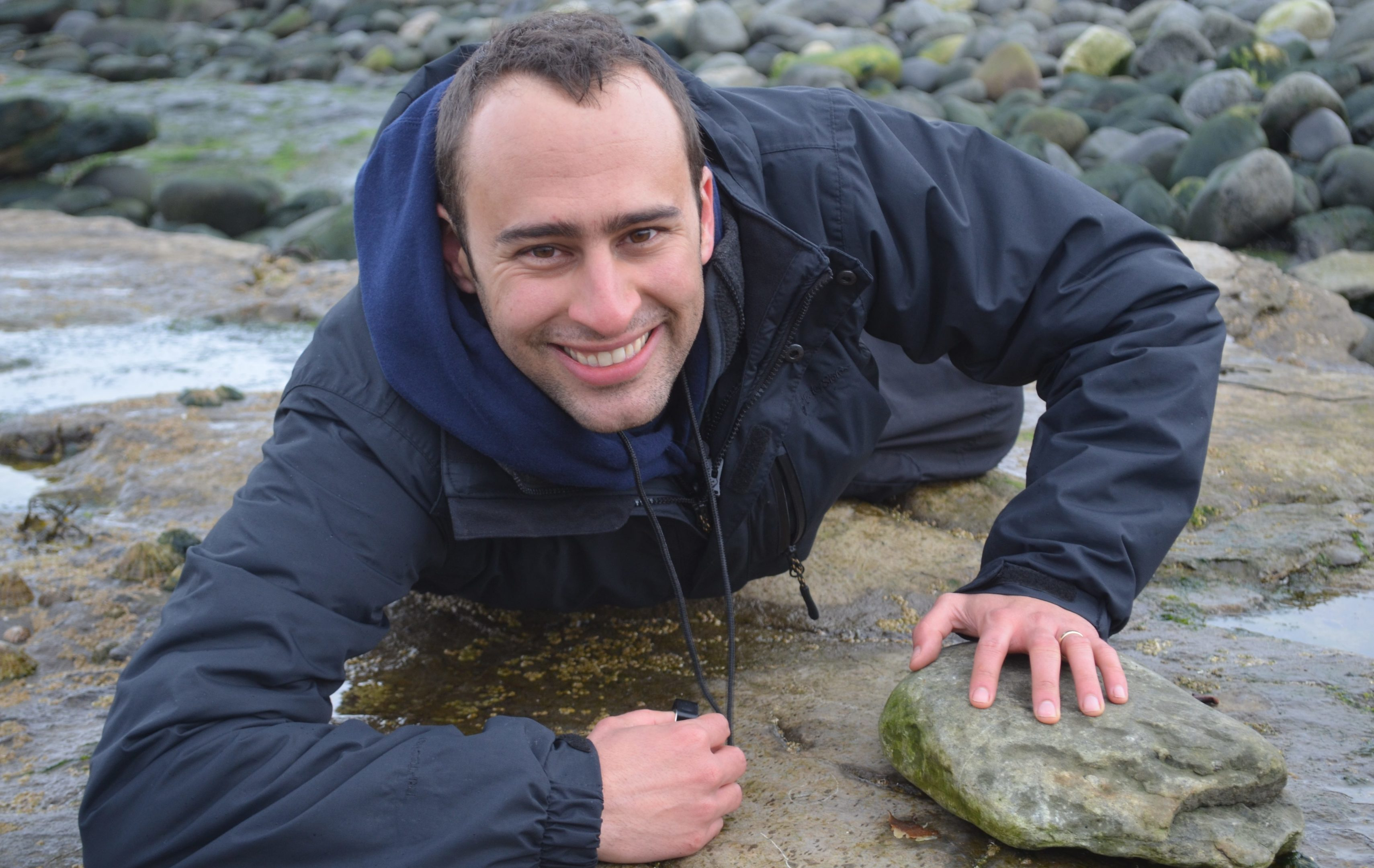 Dr Steve Brusatte hunting for dinosaur fossils on the Isle of Skye