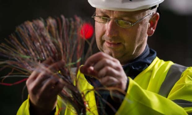 Openreach engineer Alistair Mcgowan working on the rollout of high-speed fibre broadband.