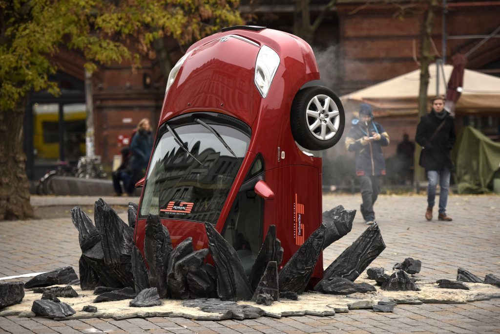 A car 'crashed' into the ground at Hackescher Markt in Berlin, Germany on November 15, 2016, ahead of the launch of Jeremy Clarkson, Richard Hammond and James May's new show, 'The Grand Tour'.