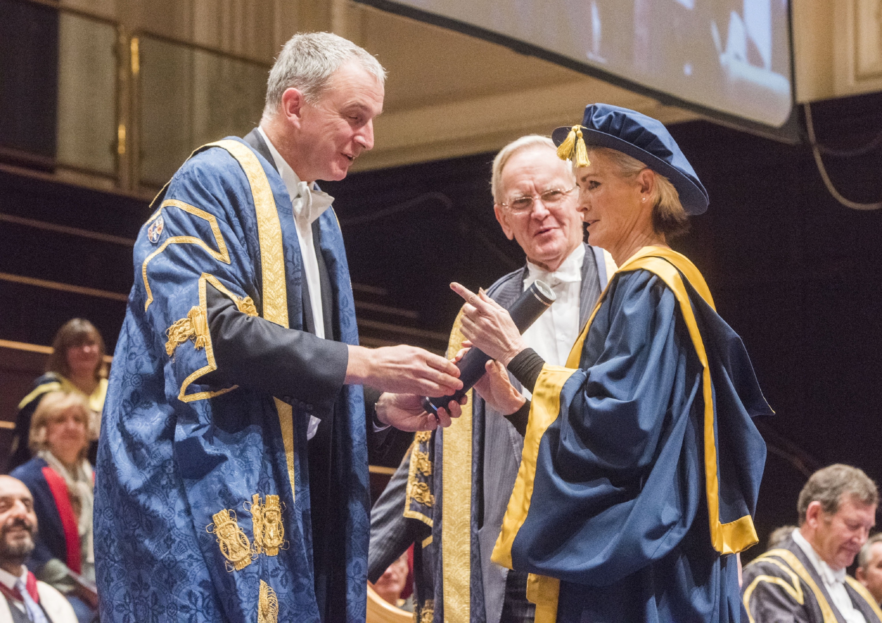 Abertay principal Nigel Seaton and Chancelor Lord Cullen present Judy Murray with her honorary degree from Abertay University in Dundee