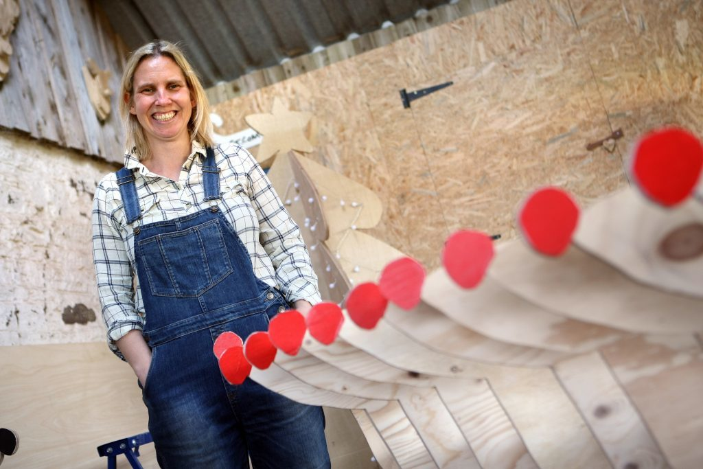 Ellen Watt with some of the festive wooden reindeer she makes at Drumtogle Farm