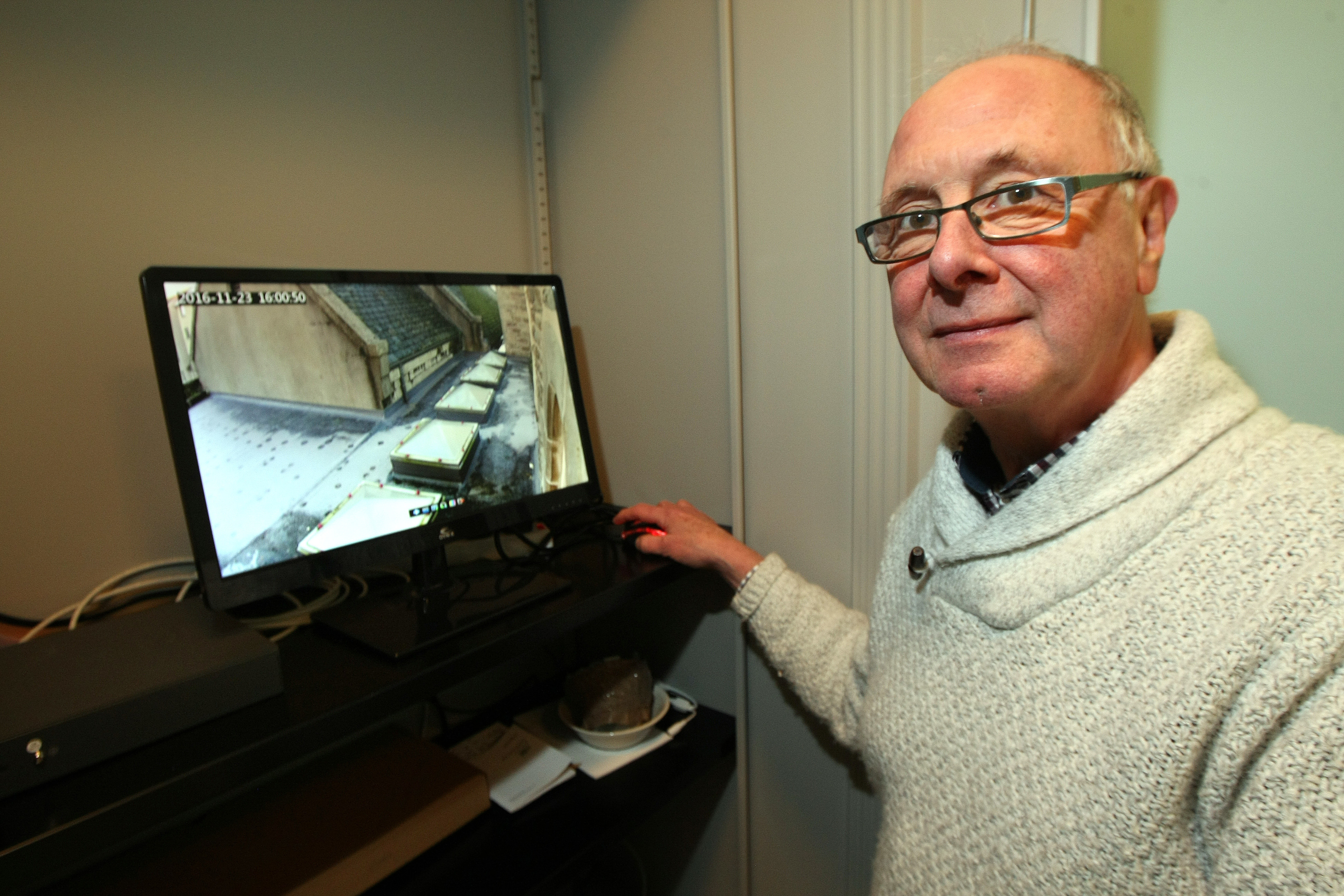 Reverend Thornthwaite with the church CCTV