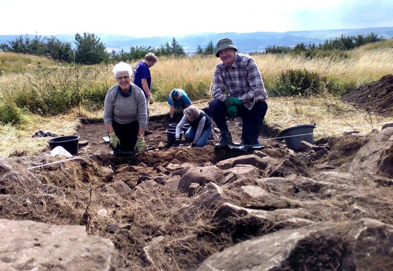 Volunteers digging at the Moredun Top hillfort site by Perth.