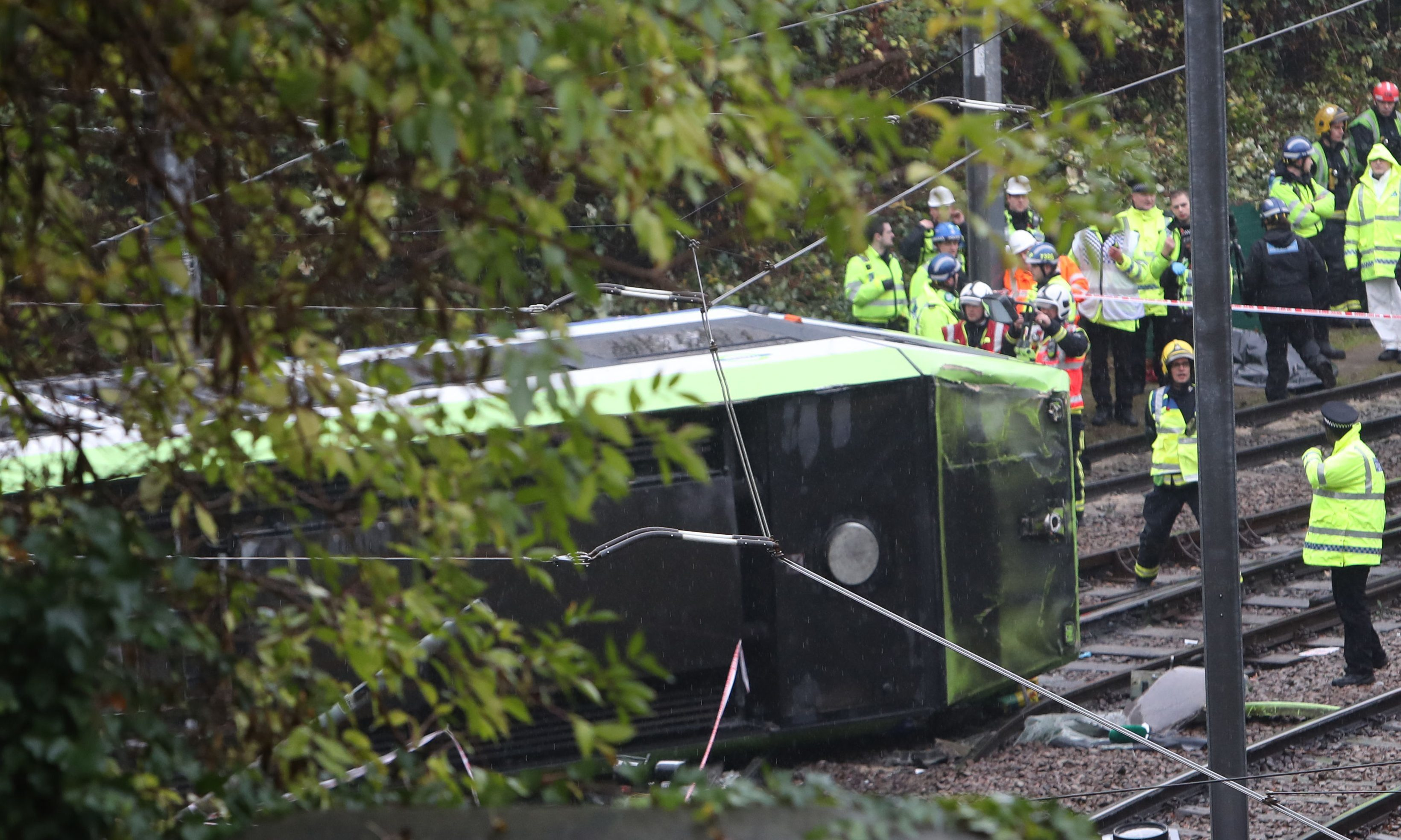The scene after a tram overturned in Croydon, south London.