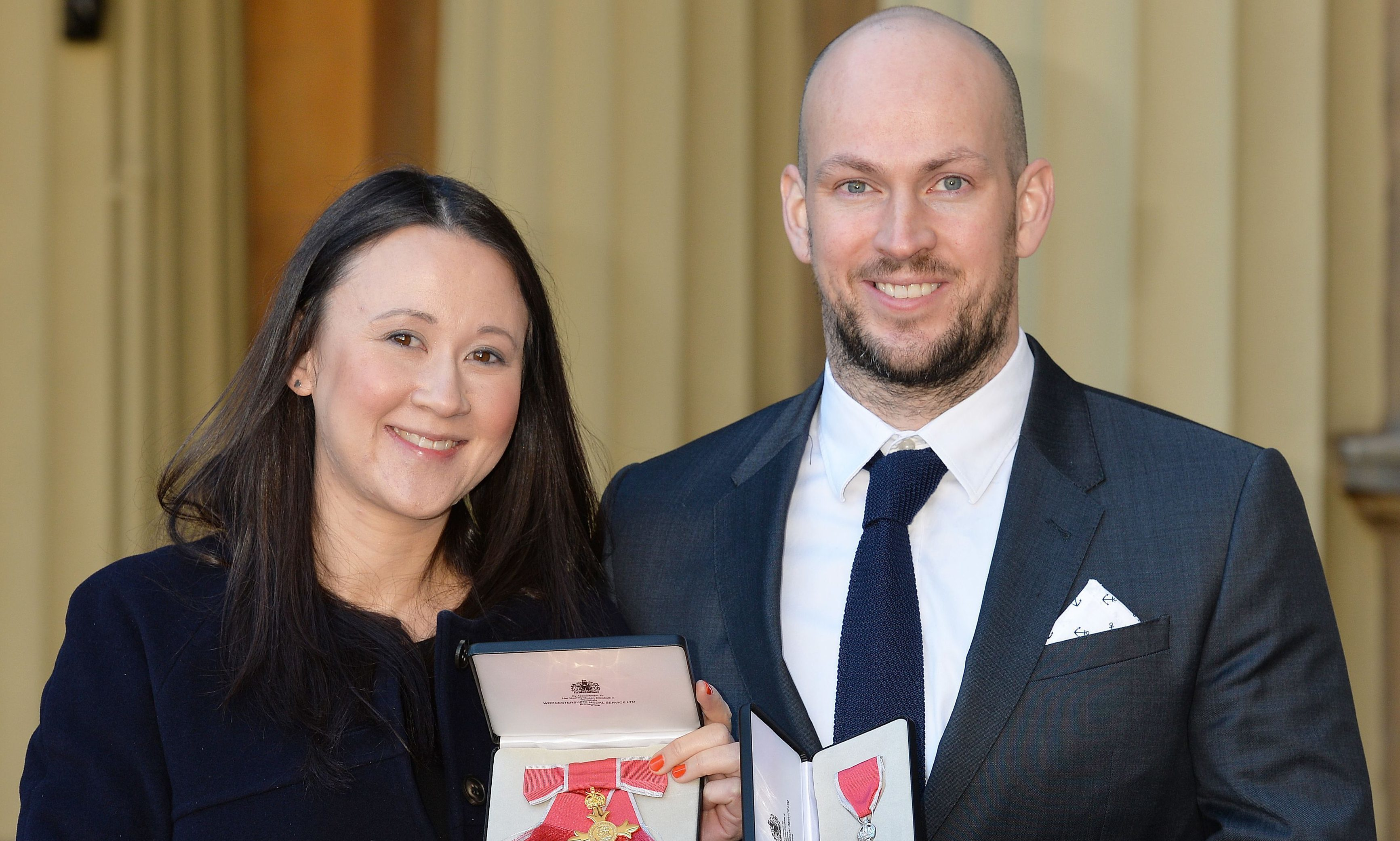 Johanna Basford with her OBE and husband James Watt with his MBE which they received from the Duke of Cambridge during an investiture ceremony at Buckingham Place in 2016.