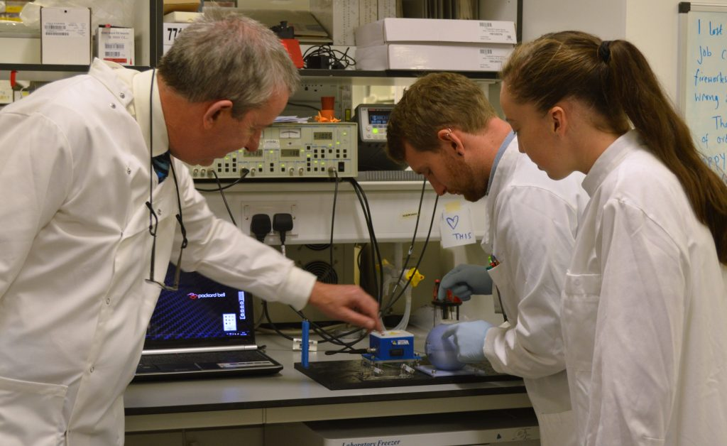 L to R - Stephen Gillespie, Robert Hammond and research assistant Kerry Falconer with the prototype SLIC device.