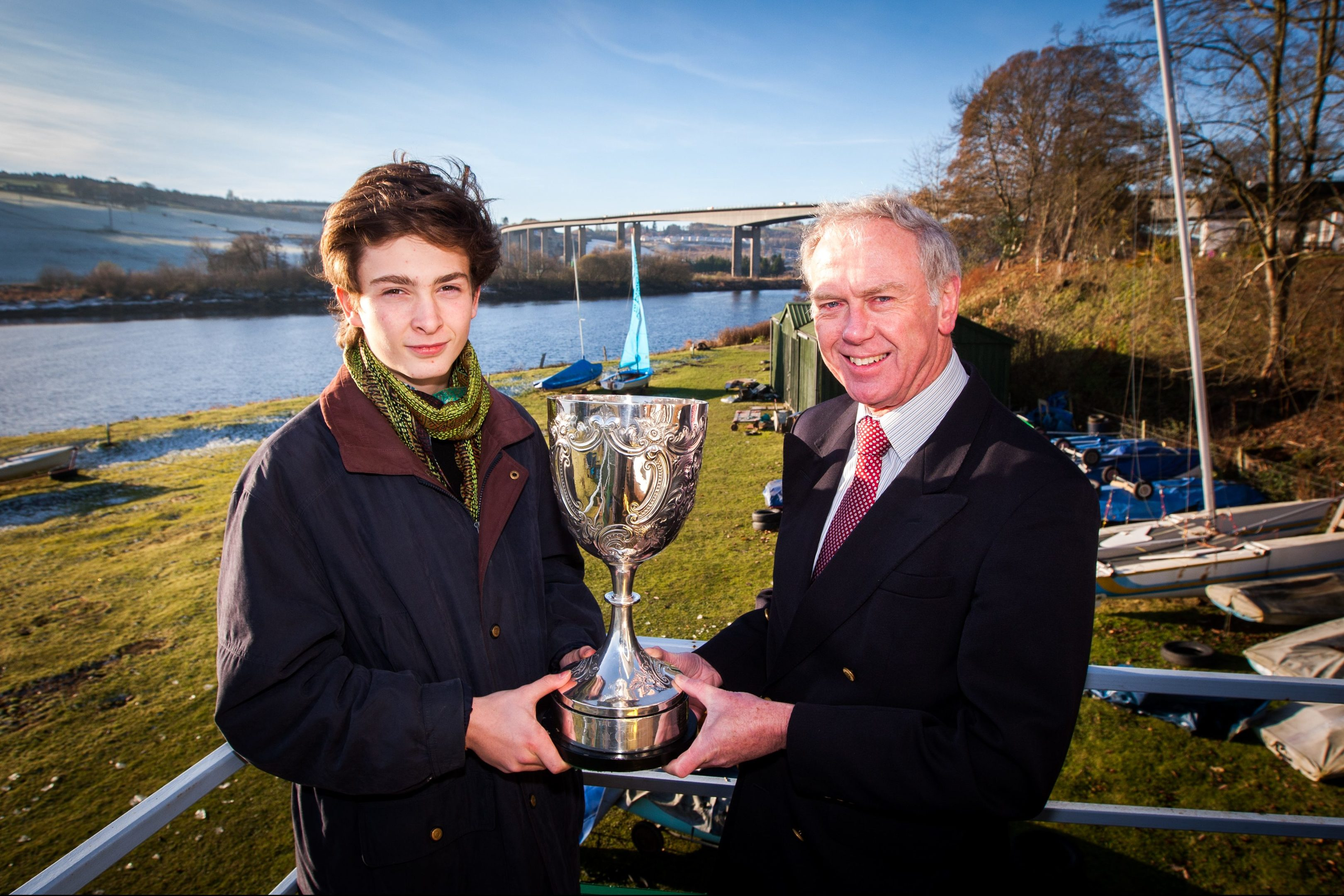 Peter Threipland receiving the Torbay Cup from the Commodore of Perth Sailing Club  Bob Watson.