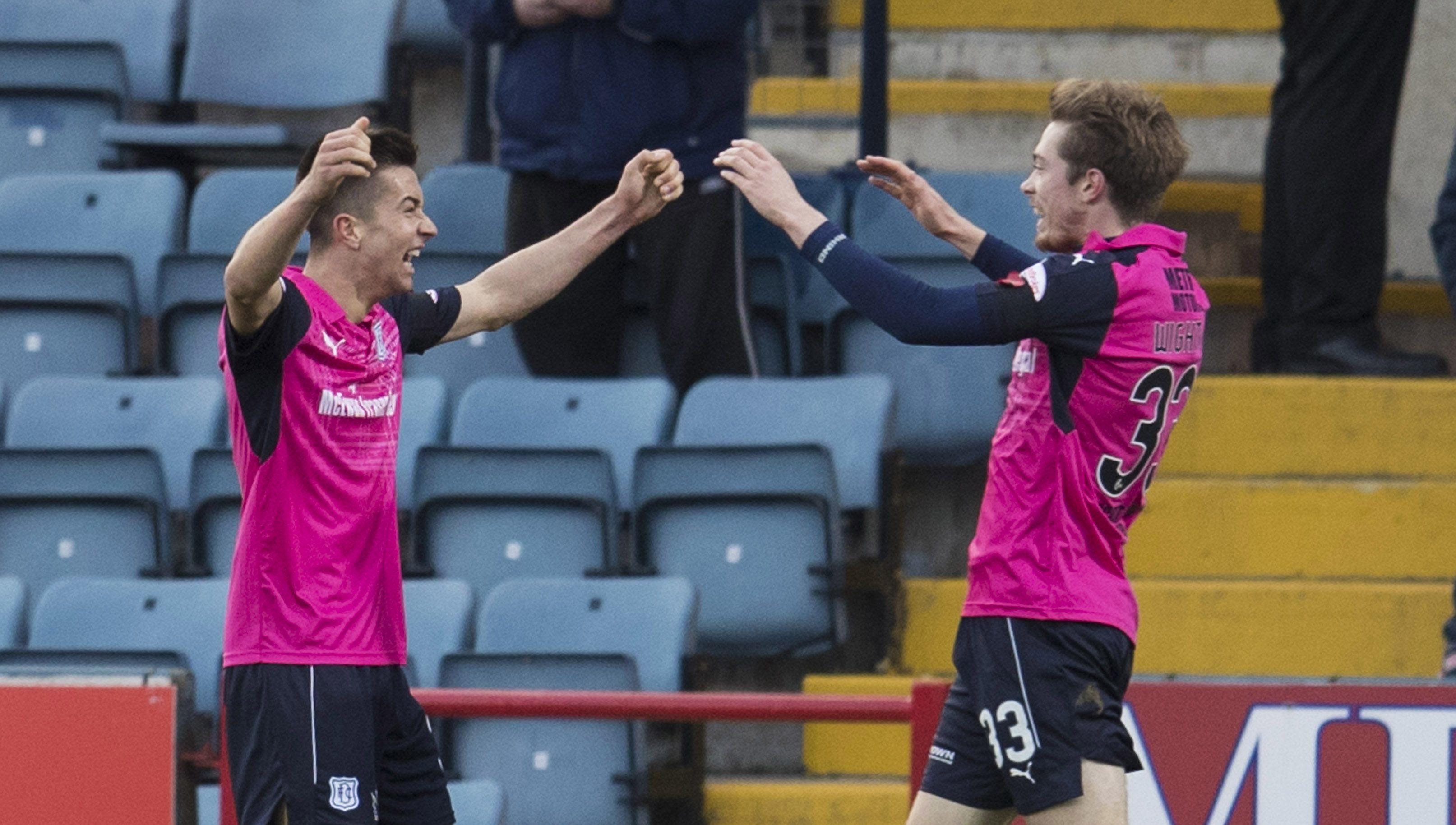 Cammy Kerr, left, celebrates his goal with Craig Wighton.